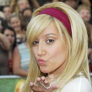 Ashley Tisdale blowing a kiss