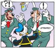 Donald lance un pot de miel devant deux gorilles