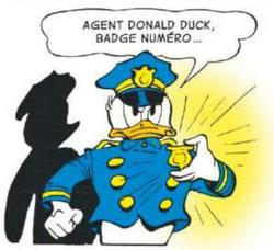 L'agent Donald Duck prêt à faire régner l'ordre