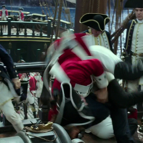 The officer watches with disgust as Henry beats up several marines. (<i>DMTNT</i>)