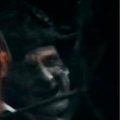 Santos holding a sword to Henry's throat. (<i>DMTNT</i>)