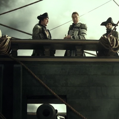 Santos and the rest of the crew prepare to fire on the surviving pirates. (<i>DMTNT</i>)