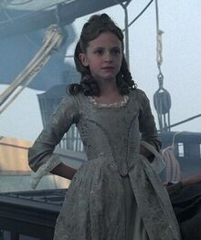 Элизабет Суонн в детстве на корабле