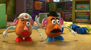 Mr. and Mrs. Potato Head and Aliens In Toy Form