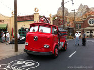 Red driving down the streets of Cars Land