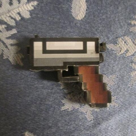 A Pixel Gun made out of paper.