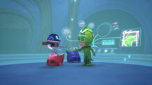 PJ Robot gives Gekko the remote control to control the propellers on Catboy and Owlette's helmets