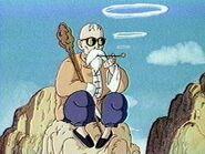 Muten Roshi paląc fajkę podziwia poczyniania Goku i Kulilina