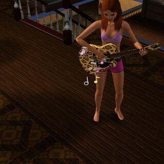 Simka grająca na gitarze.