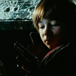 Tony with a gun.