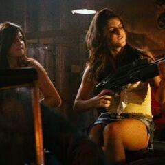 Crazy Babysitter arms herself with a gun.
