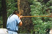 1024px-Blowgun demonstration in Oconaluftee Indian Village, Cherokee, North Carolina