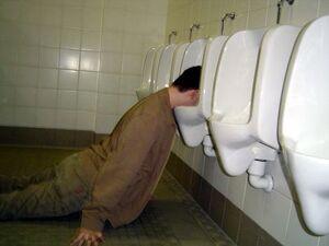 Drunk-man-in-urinal