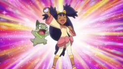 Iris catches a Pokémon
