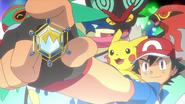 Ash met zijn achtste Badge