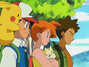 Ash,Misty y Brock contemplando ciudad verde