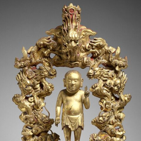 Golden baby Buddha statue from the middle time of the Lê dynastyball.