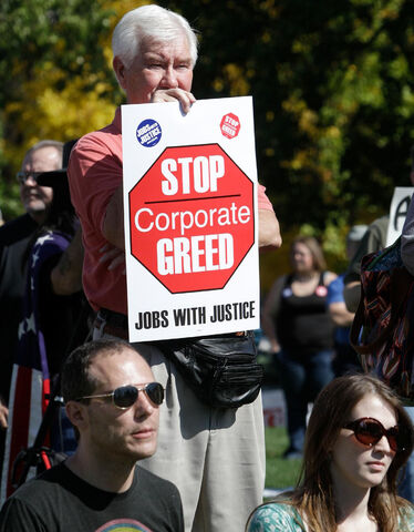 File:Sign- stop greed1.jpg