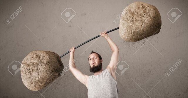 File:21528206-Funny-skinny-guy-lifting-large-rock-stone-weights-Stock-Photo.jpg