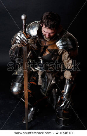 Stock-photo-tired-warrior-trying-to-stand-up-41073610