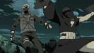 Obito slashes Kakashi