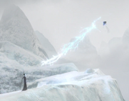 Jack Frost use the staff to blast an icy beam