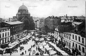 Plac wroniecki 1910 - synagoga w tle