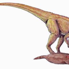 Herrerasaurus comiendo un mamifero.