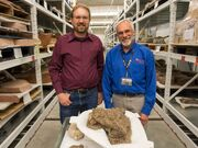 Randy Irmis, Utah Museum of Natural History paleontology curator and volunteer Randy Johnson, stand by the skull of an ankylosaurid dinosaur called the Akainacephalus johnsoni.