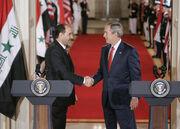 Bush al-Maliki handshake