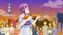 STPC25 Madoka holds the gun