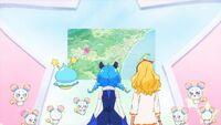 STPC23 Prunce, Yuni and Elena look at the map