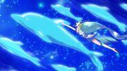 Cure Mermaid nadando con los delfines