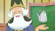 14. El profesor Isaac contando a sus alumnas su nueva prueba