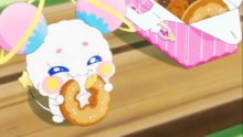 STPC09 Fuwa happily eating her star Donut