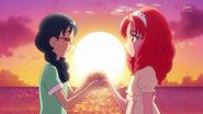 Yui entrgandole la Llave Vestir Sol a Towa