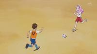 Kotoha runs towards Souta with the ball