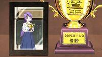 STPC16 A photo of Madoka holding a trophy