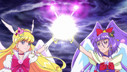 Miracle and Magical using their Linkle Sticks to Deliver Final Blow