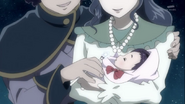 A young Riko with her parents