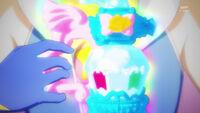 STPC21 Cosmo holds the Rainbow Perfume
