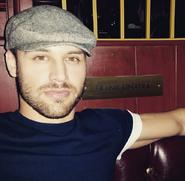 Ryan Guzman with a hat