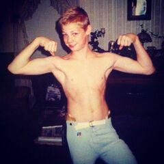 a young Brandon flexing