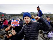 Julian holding a tiny flag