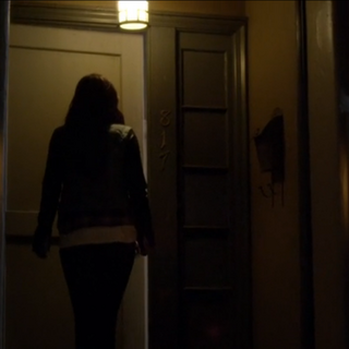 Emily walking out of a room