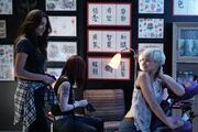Sara and emily in tattoo parlour