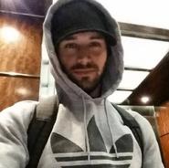 Ryan Guzman with a hoodie