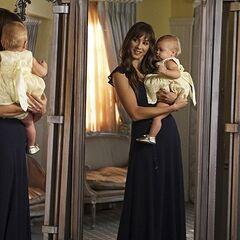 Alex holding Emison's baby