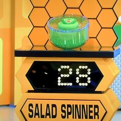 He bids $20 on the salad spinner. A difference of $8. He picks card #4.