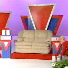 Her second clue is to eliminate the prize that starts with a 9. She picks the love seat.